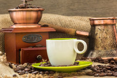 Fresh coffee with coffee pot and wooden grinder at roasted bio c Royalty Free Stock Photo