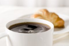 Fresh coffee and croissant Stock Photography