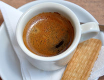 Fresh coffee in a cup and biscuits Stock Photography
