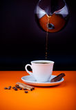 Fresh coffee cup filling from coffeepot Stock Photo