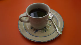 Fresh coffee cup over a hadcrafted mexican plate Stock Image