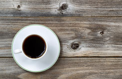 Fresh Coffee in Cup and saucer on aged wood Stock Photography