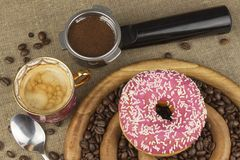 Fresh coffee and a donut. Sweet treats to hot coffee. Traditional dessert Stock Photo