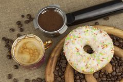 Fresh coffee and a donut. Sweet treats to hot coffee. Traditional dessert Stock Photography