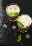 Fresh coffee drinks frappes with froth in transparent glasses wi Royalty Free Stock Image