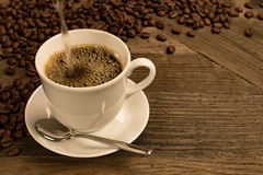 Fresh coffee filled in cup. Royalty Free Stock Photo