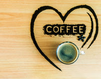 Fresh coffee with heart make form coffee grind Royalty Free Stock Photography