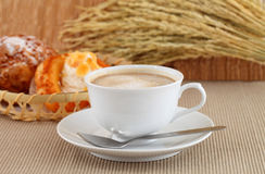 Fresh coffee and the morning bread chou cream. Royalty Free Stock Photos