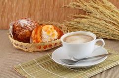 Fresh coffee and the morning bread chou cream. Stock Photos