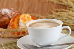 Fresh coffee and the morning bread chou cream Royalty Free Stock Photography