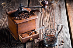 Fresh coffee and old grinder Stock Photo