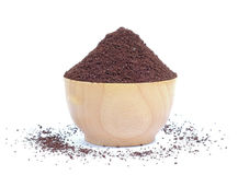 Fresh coffee powder in wood bowl on white background. Royalty Free Stock Photography