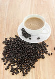 Fresh coffee in a white cup Stock Photography