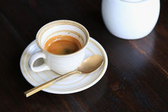 Fresh coffee on wooden table. Espresso coffee short on table Royalty Free Stock Image