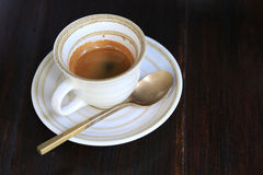 Fresh coffee on wooden table. Espresso coffee short on table Royalty Free Stock Images