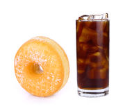 Fresh coke in glass and sandwich cookies isolated on a white royalty free stock image