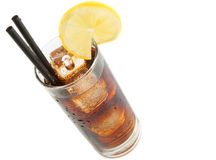 Fresh coke with straw with lemon slice on top, summer time Royalty Free Stock Image