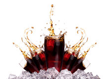 Fresh cola drink background with ice. And splash isolated on a white Royalty Free Stock Image