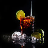 Fresh cola drink with green lime Stock Photos