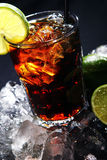 Fresh cola drink with green lime Stock Photography