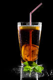 Fresh cola drink with limes. on black background Stock Image