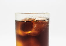 Fresh cola in glass on white Royalty Free Stock Images