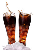 Fresh Cola with ice cubes. On a white background royalty free stock photography