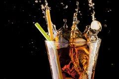 Fresh cola juice and ice cubes splash Royalty Free Stock Photo