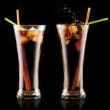 Fresh cola juice and ice cubes splash Stock Photography