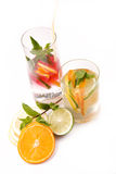 Fresh cold cocktail in glass with sliced citus Stock Photography
