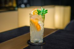 Fresh, cold cocktail on the table, with a beautiful bokeh. Citrus drink with soda and alcohol. Fresh, cold cocktail on the table, with a beautiful bokeh in the Stock Images
