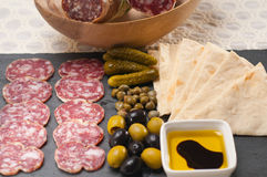 Cold cut platter with pita bread and pickles. Fresh cold cut platter with pita bread and pickles antipasti stock photography