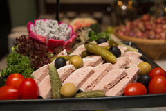 Fresh cold cut platter  served as a cold buffet. Assorted fresh cold cut platter  served as a cold buffet Stock Photo