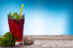 Fresh cold drink. On blue Royalty Free Stock Photos