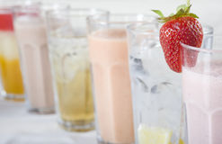 Fresh cold drinks in a row. Row of frshly made cold drinks with a fresh strawberry Stock Images