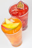 Fresh cold drinks. Two fresh cold drinks with fruit flavour and ice cubes Royalty Free Stock Photo