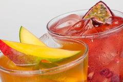 Fresh cold drinks. Two fresh cold drinks with fruit flavour and ice cubes Stock Photos