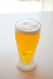Fresh and cold foamy beer Stock Photos