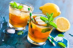 Fresh cold iced tea with mint, ice and lemons, refreshing drink Royalty Free Stock Photo