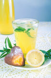 Fresh cold lemonade with mint leaves and cookies Stock Image