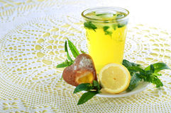 Fresh cold lemonade with mint leaves and cookies Royalty Free Stock Photos