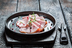 Fresh cold meats with pepper and herbs Stock Images
