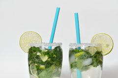 Fresh and cold Mojito cocktail on a white background. Two mojito Royalty Free Stock Photos