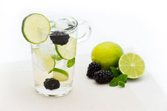 Fresh cold summer drink with lime, blackberry and mint stock image