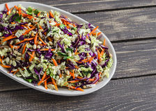 Fresh Cole slaw with pumpkin, flax, sesame seeds and pine nuts - delicious healthy vegetarian food. Stock Images