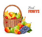 Fresh color fruit in basket. Concept of diet. Royalty Free Stock Photo
