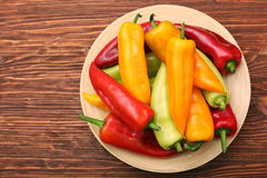 Fresh colored sweet peppers on the plate Stock Photos