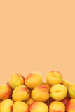 Fresh colorful apricots on a beige background Royalty Free Stock Image
