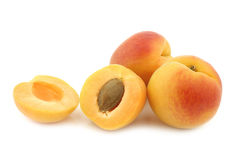 Fresh colorful apricots and a cut one Royalty Free Stock Image