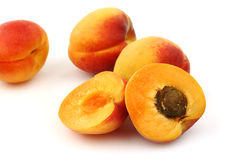Fresh colorful apricots an two halves Royalty Free Stock Photography